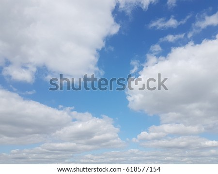 white fluffy soft clouds with a blue sky background  #618577154