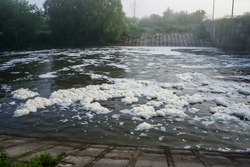 White foam floats on the river.