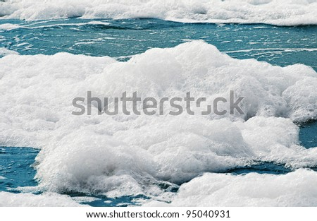 White foam on a sea water surface