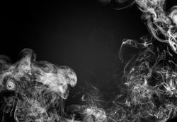 White fog or smoke on a black background.