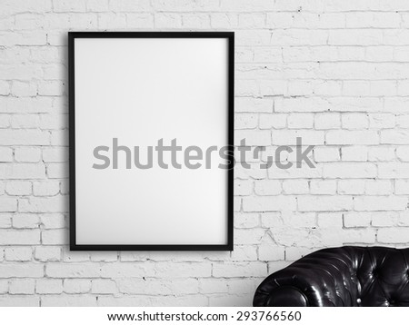 white frame hanging on a brick wall