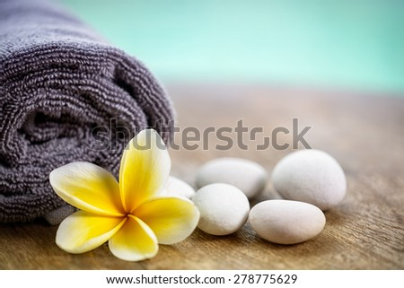 White frangipani on towel in the spa, close up  #278775629