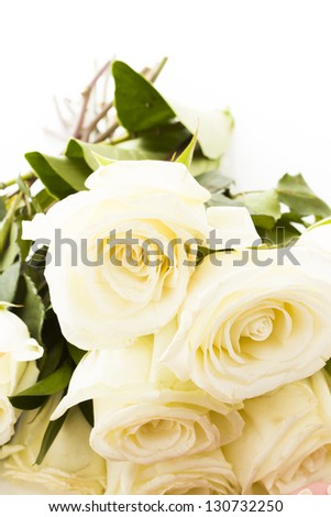 White fresh roses in a bouquet.