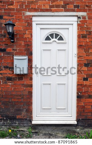 White Front Door of a Red Brick English Town House