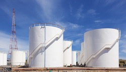 White fuel storage tank against blue sky
