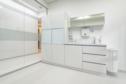 White furniture in modern dentistry medical room with special equipment