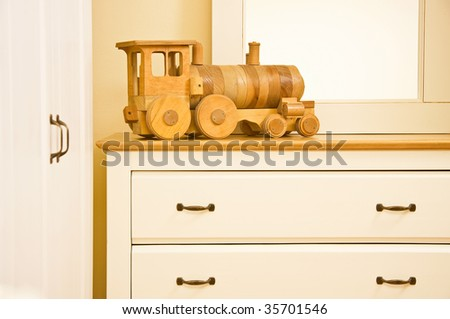 White furniture with train toy