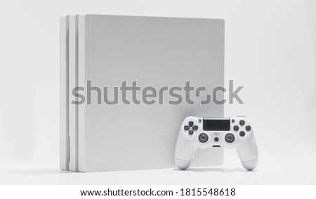 White game console and controller on with background Foto stock ©