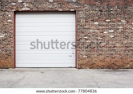 white garage door on brick wall