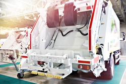 White garbage truck with a loader for all types of waste containers