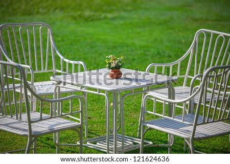 White garden furniture on green grass