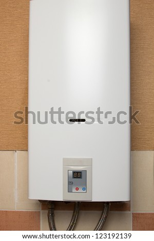 White gas water heater to the wall