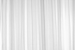 White gauze a thin translucent fabric or transparent curtain on the window sunlight filter