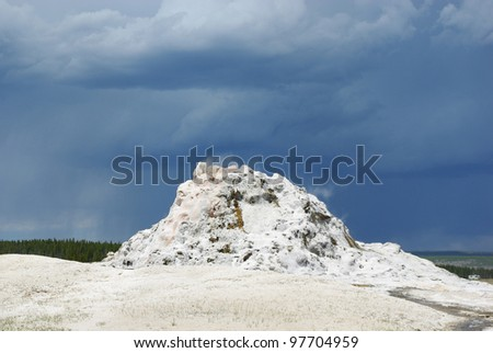 White geyser formation and gray sky, Yellowstone National Park, Wyoming