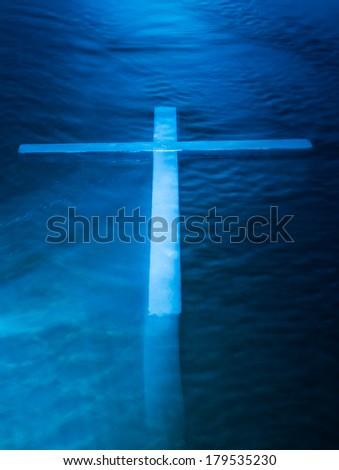 White ghost like cross on dark blue water. Stock photo ©