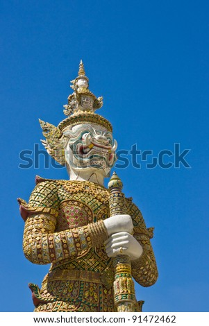 white giant image around the temple of emerald Buddha Bangkok Thailand