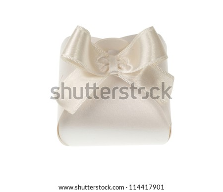 White gift box with bow on white background