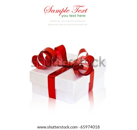 White gift box with red ribbon and bow on white background with copy space.