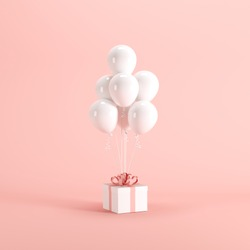 White gift box with red ribbon and white balloon on pink background. minimal christmas new year concept.