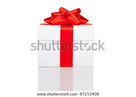 white gift box with red ribbon isolated on white