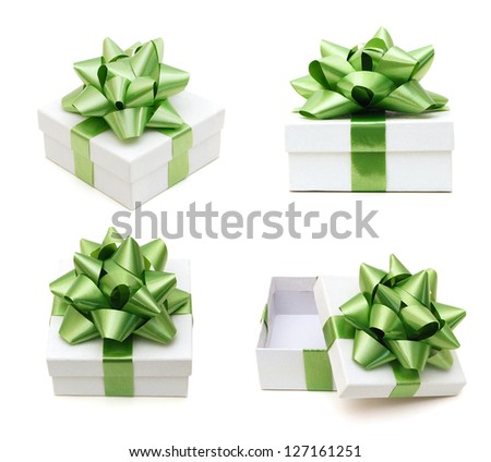 White gift boxes with a blue bow on white background