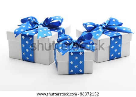 White gift boxes with blue ribbon.