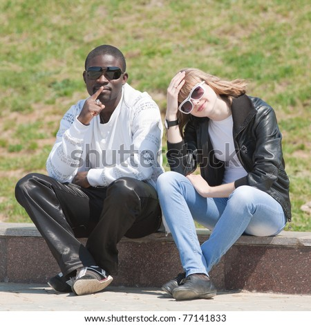 White Girl And Black Guy Outdoors. Young Man And Woman Sitting In The ...