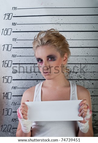 white girl in prison with injuries on ruler background