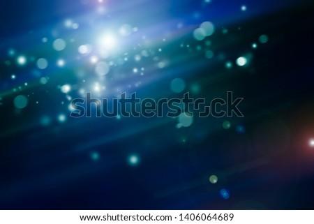 white glisten bokeh blur background / Circle light on blue background / abstract light night background