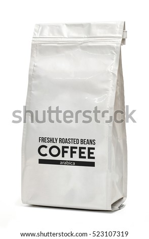 White glossy foil coffee bag packaging with valve and seal isolated on white background including clipping path #523107319
