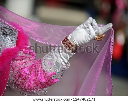 white glove with precious ring of a noble Venetian woman during the Venice carnival in Italy
