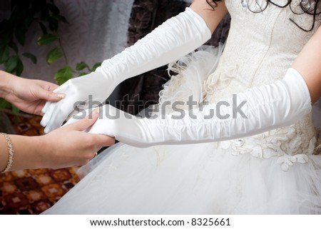 white gloves on the hands of the bride #8325661
