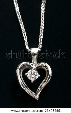 White gold heart pendant with diamond on a chain