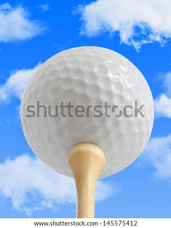 White Golf Ball on a Tee with a blue sky background