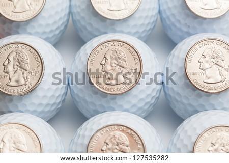 White golf balls and US dollars - stock photo