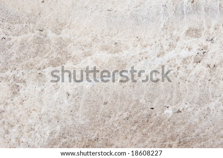 white granite counter with brown throughout it