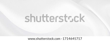 White gray satin texture that is white silver fabric silk panorama background with beautiful soft blur pattern natural. Foto stock ©