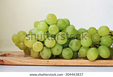 White green table grapes wet wooden board fresh cluster fruit #304463837