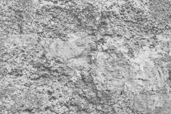 White grey texture of old weathered stone. Background of natural cliff