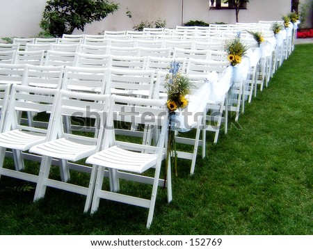 stock photo White Guest Chairs Assembled at an Upscale Outdoor Wedding