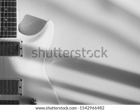 white guitar on white background . black and white
