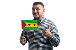 White guy holding a flag of Sao Tome and Principe and shows the class by hand isolated on a white background. Like for Sao Tome and Principe.