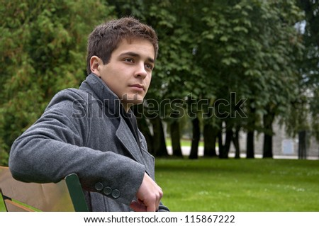 stock-photo-white-guy-in-coat-sitting-on