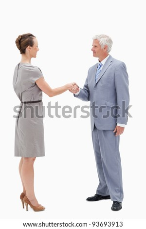 White hair businessman face to face and shaking hands with a woman against white background