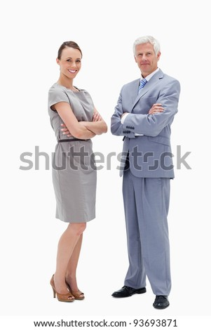 White hair man face to face with a woman crossing their arms and smiling against white background
