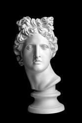 White head silhouette on black background. Gypsum statue of Apollo's head. Man. Statue. Isolated. Head. Apollo Belvedere. Black Lives Matter