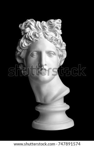 White head silhouette on black background. Gypsum statue of Apollo's head. Man. Statue. Isolated. Head. Apollo Belvedere