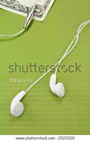 White headphones with dollar. concept of download or buy music online - stock photo