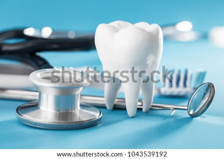 White healthy tooth, different tools for dental care. Dental background. #1043539192