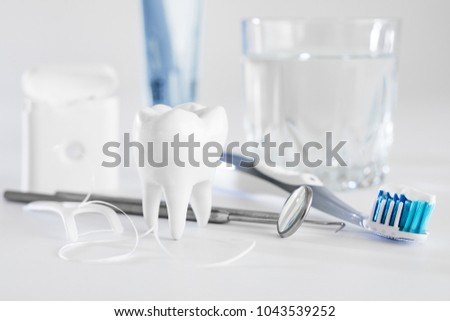 White healthy tooth, different tools for dental care. Dental background. #1043539252